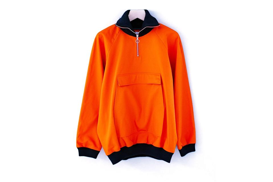 "$335, CHCM. <a href=""https://chcmshop.com/collections/all/products/anglozine-trip-mid-zip-smock-orange"" rel=""nofollow noopener"" target=""_blank"" data-ylk=""slk:Get it now!"" class=""link rapid-noclick-resp"">Get it now!</a>"