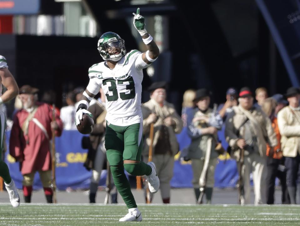 New York Jets safety Jamal Adams celebrates after he intercepted a pass for a touchdown in the second half of an NFL football game against the New England Patriots, Sunday, Sept. 22, 2019, in Foxborough, Mass. (AP Photo/Steven Senne)