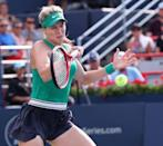 Aug 7, 2018; Montreal, Quebec, Canada; Eugenie Bouchard of Canada hits a shot against Elise Mertens of Belgium (not pictured) in the Rogers Cup tennis tournament at IGA Stadium. Mandatory Credit: Jean-Yves Ahern-USA TODAY Sports