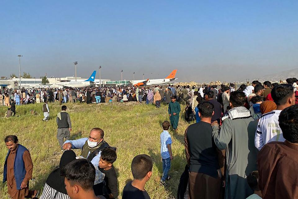 Afghans crowd at the airport as they wait to leave from Kabul on August 16, 2021. (Photo by Shakib Rahmani / AFP) (Photo by SHAKIB RAHMANI/AFP via Getty Images)