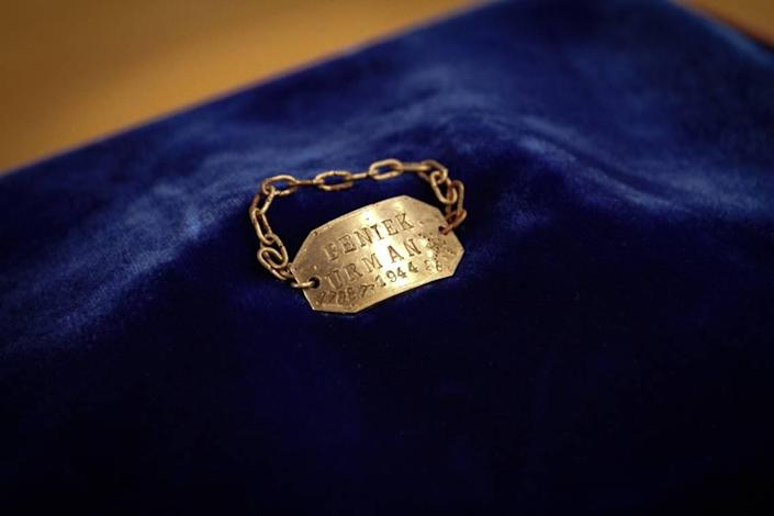 Ben Farien is believed to have made the bracelet while working as a metalworker at the Blechhammer camp. Engraved on the bracelet is his name, mother's maiden name and identification number.
