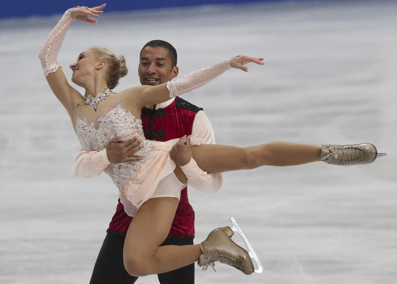 Aliona Savchenko and Robin Szolkowy of Germany perform during the pairs free skating in the World Figure Skating Championships in Saitama, near Tokyo, Thursday, March 27, 2014. The German pair won the gold medal. (AP Photo/Koji Sasahara)