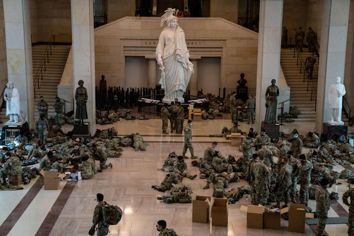 Dozens of National Guard troops relax in the Capitol Visitor Center on Capitol Hill.