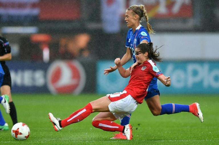 Austria's Sarah Zadrazil challenges Iceland's Dagny Brynjarsdottir (back) during their UEFA Women's Euro 2017 match, at the Sparta Stadium in Rotterdam, on July 26