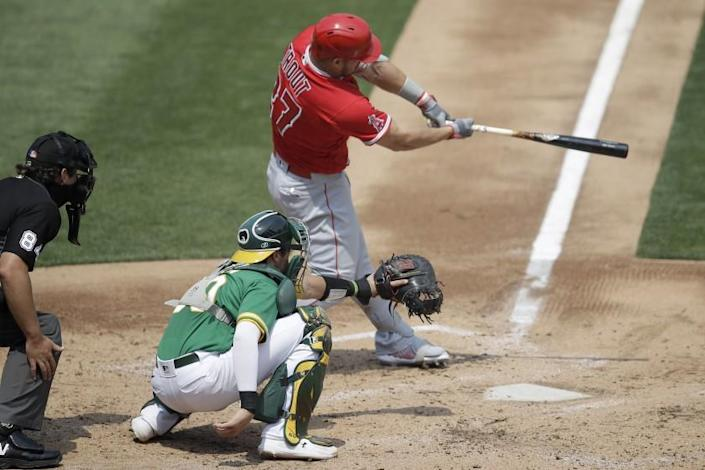 "The Angels' Mike Trout connects for a two-run double in the second inning Saturday. <span class=""copyright"">(Ben Margot / Associated Press)</span>"