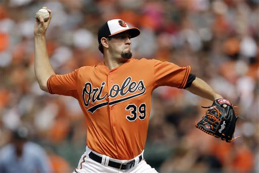 Baltimore Orioles starting pitcher Jason Hammel throws to the Toronto Blue Jays in the first inning of a baseball game, Saturday, July 13, 2013, in Baltimore. (AP Photo/Patrick Semansky)