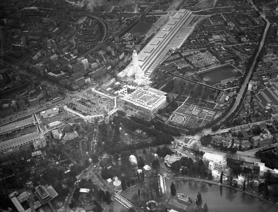 """FILE - In this May 6, 1931 file photo, the Paris Colonial Exhibition, from the air, encompassing 110 hectares of the Bois de Vincennes. The exhibition included dozens of temporary museums and facades representing the various colonies of the European nations, as well as several permanent buildings. Pap Ndiaye, a Black French scholar and expert on U.S. minority rights movements who is taking over France's state-run immigration museum, considers it """"vital"""" for his country to confront its colonial past so that it can conquer the racial injustice of the present. (AP Photo, file)"""