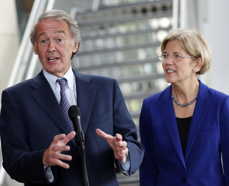 FILE - In this Oct. 3, 2012 file photo, Rep. Ed Markey, D-Mass., left, accompanied by then-Democratic Senate candidate Elizabeth Warren, gestures as he speaks with reporters as she campaigned in Medford, Mass.  Markey said Thursday, Dec. 27, 2012 that he plans to run for John Kerry's Senate seat if Kerry is confirmed by his fellow senators to become the nation's new secretary of state.    (AP Photo/Michael Dwyer, File)