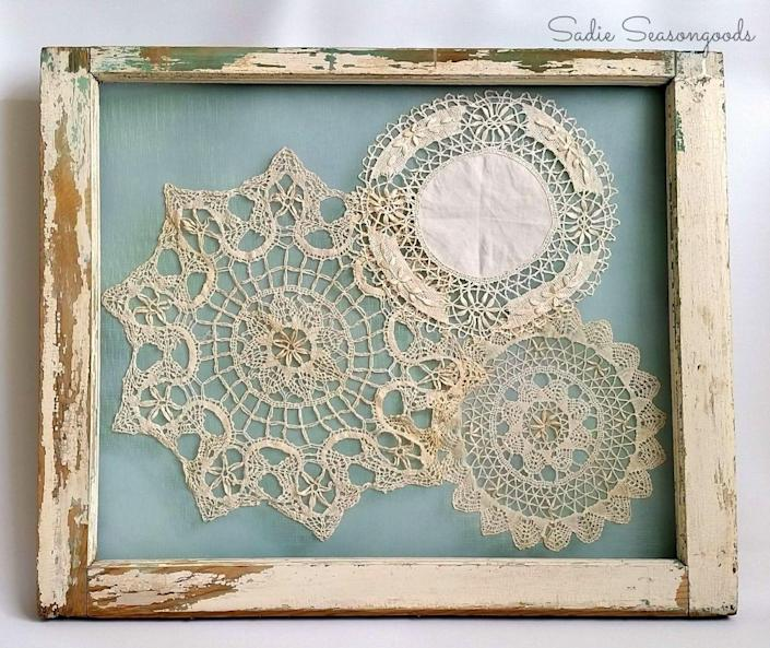"<p>Make this easy and striking piece of art in a few easy steps: Sew doilies in place on a fine mesh screen attached to an old picture frame or chippy painted window frame, as used here.</p><p><br></p><p><strong>See more at <a href=""http://www.sadieseasongoods.com/master-bedroom-evolution-and-doily-display-2/"" rel=""nofollow noopener"" target=""_blank"" data-ylk=""slk:Sadie Seasongoods"" class=""link rapid-noclick-resp"">Sadie Seasongoods</a>.</strong></p>"