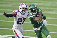 Buffalo Bills' Tre'Davious White, left, chases New York Jets' Chris Hogan during the first half of an NFL football game, Sunday, Oct. 25, 2020, in East Rutherford, N.J. (AP Photo/John Minchillo)