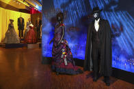 """Costumes from the Broadway musical """"The Phantom of the Opera"""" are displayed at the """"Showstoppers! Spectacular Costumes from Stage & Screen"""" exhibit, benefitting the Costume Industry Coalition Recovery Fund, in Times Square on Monday, Aug. 2, 2021, in New York. (Photo by Andy Kropa/Invision/AP)"""