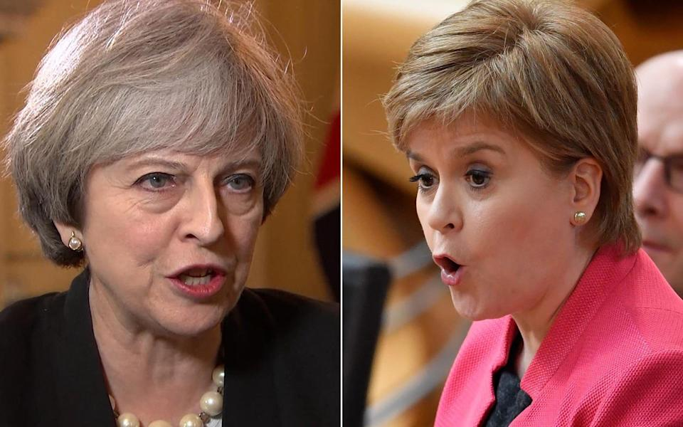 Theresa May will call Nicola Sturgeon's bluffby challenging her to prove at the next Scottish elections in 2021 her claim that she has a 'cast iron' mandate for a new referendum - PA/GETTY IMAGES
