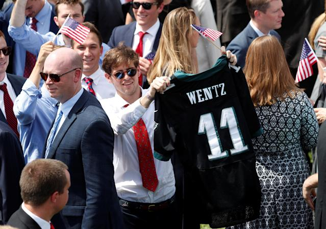 "A guest holds up the NFL jersey of Philadelphia Eagles quarterback Carson Wentz at U.S. President Donald Trump's ""celebration of America"" event on the South Lawn of the White House in Washington, U.S., June 5, 2018. The event was arranged after Trump canceled the planned visit of the Super Bowl champion Philadelphia Eagles to the White House. REUTERS/Kevin Lamarque"