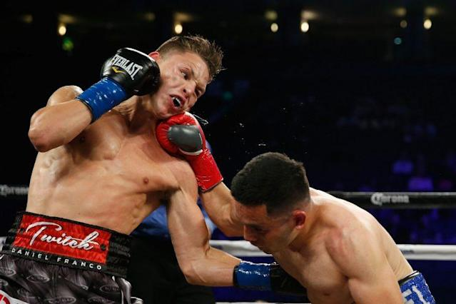 Daniel Franco (L), shown in a 2016 bout with Marcello Gallardo, is in a medically induced coma as a result of injuries he suffered Saturday. (Getty Images)