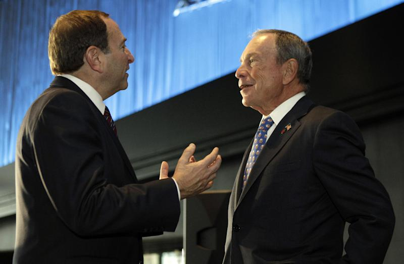 National Hockey League Commissioner Gary Bettman, left, chats with New York Mayor Michael Bloomberg following a press conference, Wednesday, Oct. 24, 2012 in New York, announcing that the New York Islanders will move from Nassau Veterans Memorial Coliseum in Uniondale, N.Y., and play at Brooklyn's Barclays Center starting in 2015. (AP Photo/Kathy Willens)