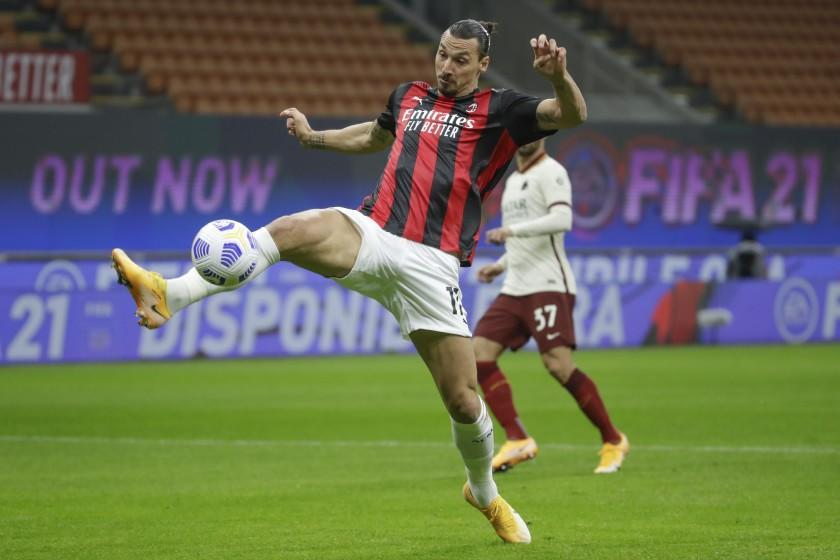 AC Milan's Zlatan Ibrahimovic scores his side's opening goal during the Serie A soccer match between AC Milan and Roma at the Milan San Siro Stadium, Italy, Monday, Oct. 26, 2020. (AP Photo/Luca Bruno)
