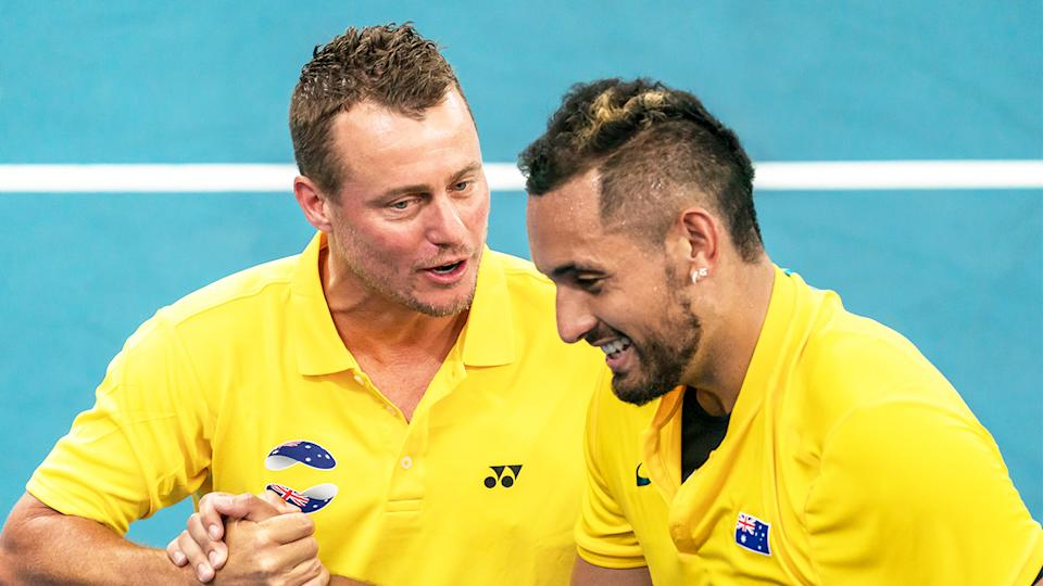 Lleyton Hewitt (pictured left) celebrates with Nick Kyrgios (pictured).