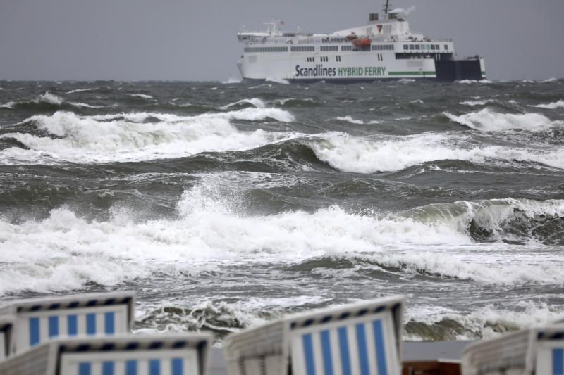 A ferry leaves the harbour as high waves are seen on the Baltic Sea in Warnemuende, eastern Germany, on a stormy Monday, Sept.30, 2019. (Bernd Wuestneck/dpa via AP)