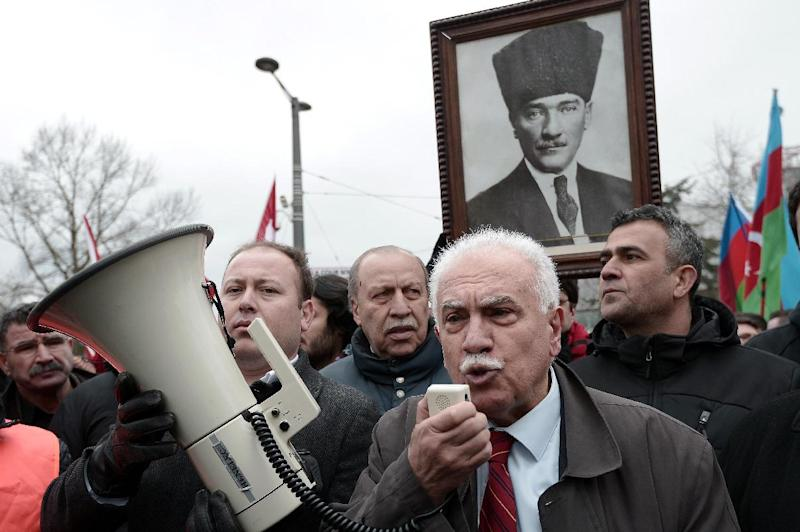 Turkish politician Dogu Perincek (C) from the Left-wing Turkish Workers' Party speaks on January 28, 2015, after his hearing before the European Court of Human Rights in the eastern French city of the Strasbourg (AFP Photo/Frederick Florin)