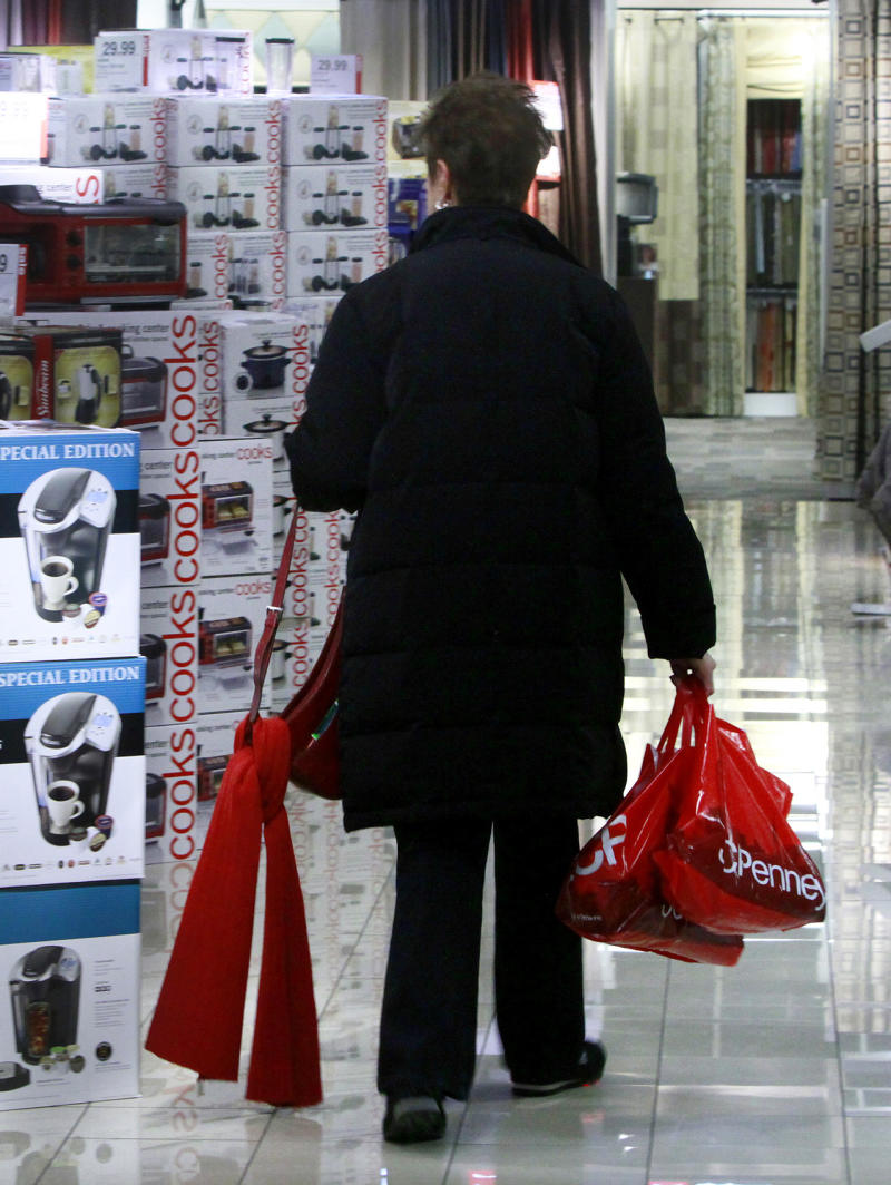 FILE - In this Dec. 16, 2010 file photo, a shopper eyes cooking ware gift sets at the J.C. Penney store at Herald Square, New York. J.C. Penney Co. said Monday, May 16, 2011, its first-quarter net income rose nearly 7 percent because of cost-cutting and strong reception to its exclusive merchandise. (AP Photo/Bebeto Matthews, file)
