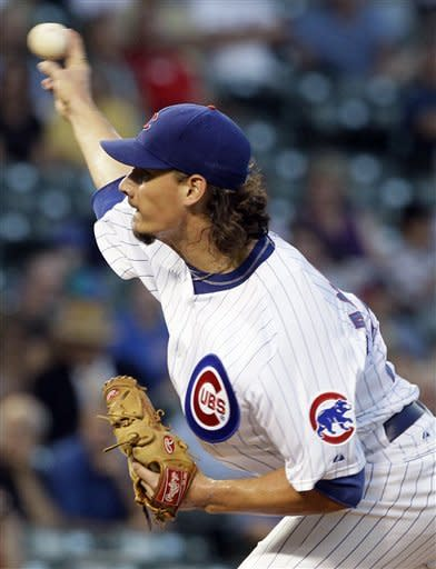 Chicago Cubs starter Jeff Samardzija throws against the Milwaukee Brewers during the first inning of a baseball game in Chicago, Wednesday, Aug. 29, 2012. (AP Photo/Nam Y. Huh)