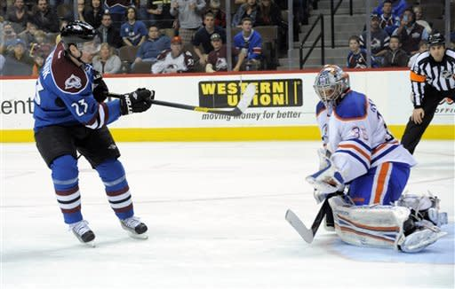 Colorado Avalanche right winger Milan Hejduk (23) from the Czech Republic scores a shoot out goal against Edmonton Oilers goalie Nikolai Khabibulin (35) from Russia during an NHL hockey game on Saturday, March 10, 2012, in Denver. The Avalanche beat the Oilers 3-2 in an overtime shoot out. (AP Photo/ Jack Dempsey)