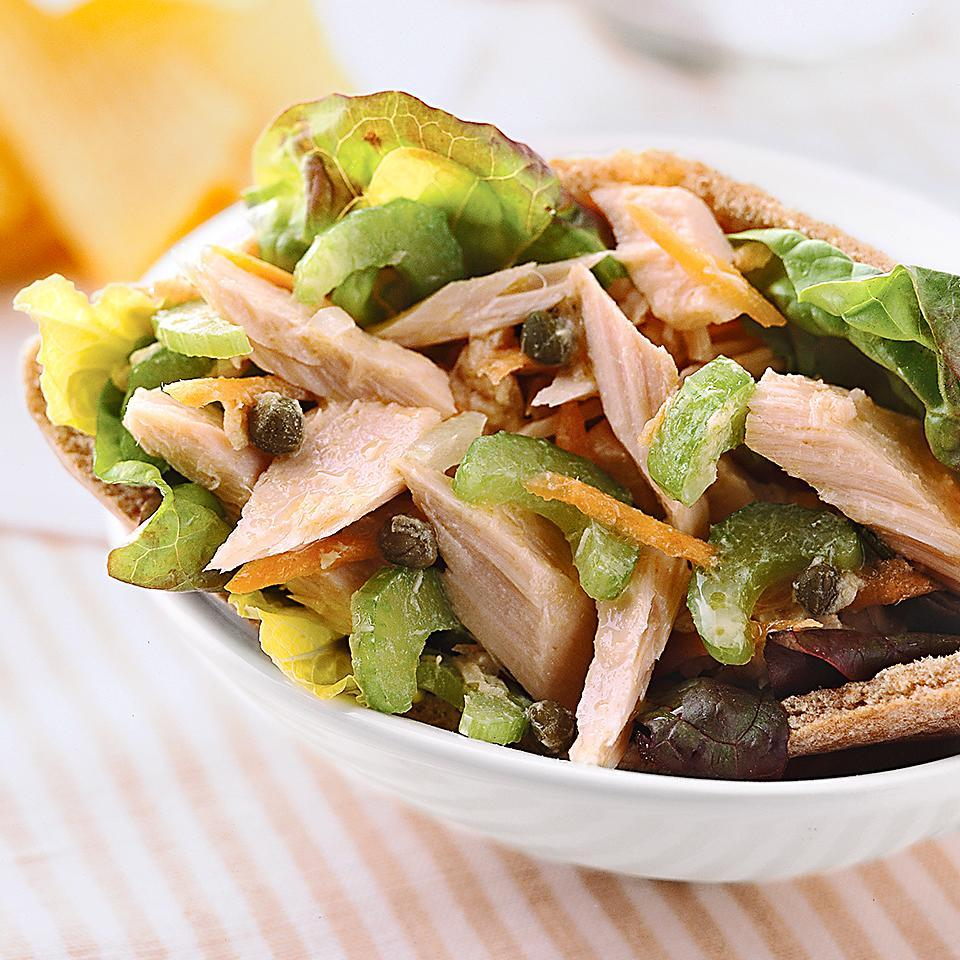 <p>Tuna salad served with pita bread halves has a zesty vinaigrette dressing, capers for flavor, and almonds for crunch. Your delicious lunch is ready in just a few minutes.</p>