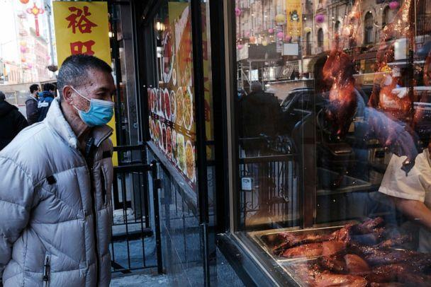 PHOTO: People walk through the streets of Chinatown on March 02, 2021, in New York. (Spencer Platt/Getty Images)