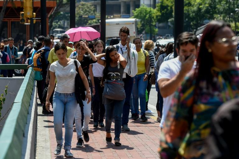 Commuters unable to use the subway due to a partial power cut, flock to the streets in Caracas
