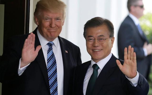 Donald Trump, the US president, and Moon Jae-in, the president of South Korea, at the White House last June - REUTERS