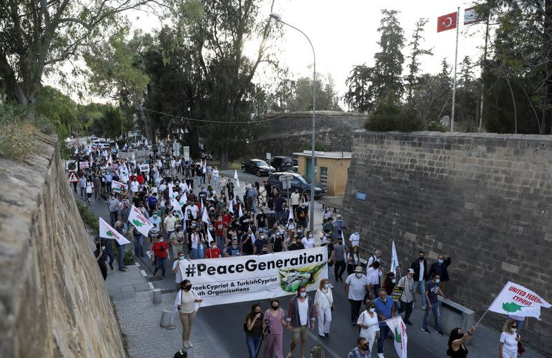 Greek Cypriots march peacefully during a reunification rally along the medieval walls circling the divided capital Nicosia