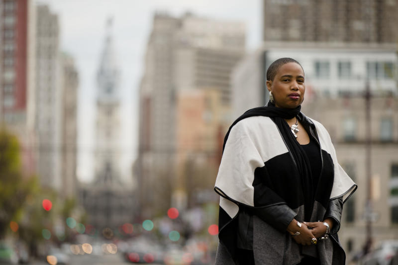"""Filmmaker and writer Aishah Shahidah Simmons, who teaches in the women's and LGBT studies program at Temple University, poses for a photograph Friday, April 25, 2014, in Philadelphia. Students on college campuses across the country are increasingly asking their professors to provide """"trigger warnings"""" for classes that cover content that might be upsetting to individuals who have been sexually assaulted, touched by suicide, survived war or experienced other traumatic situations. Such warnings, long a feature of the blogosphere, are now cropping up on course syllabi or before lectures. Simmons is a rape and incest survivor who is """"on the fence"""" about making trigger warnings mandatory for college faculty, but already uses them in her courses. (AP Photo/Matt Rourke)"""