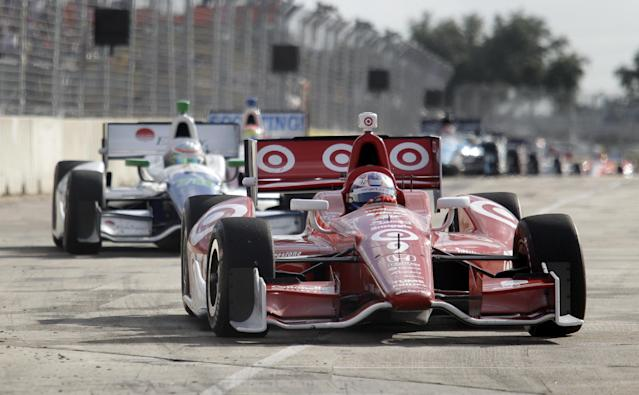 Scott Dixon, of New Zealand, leads the pack under caution during the first IndyCar Grand Prix of Houston auto race, Saturday, Oct. 5, 2013, in Houston. Dixon won the race. (AP Photo/Patric Schneider)