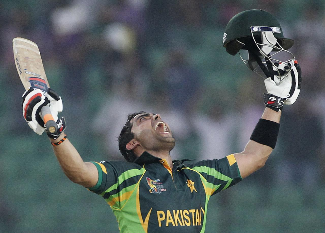 Pakistan's Umar Akmal celebrates after scoring a century against Afghanistan during their Asia Cup 2014 one-day international (ODI) cricket match in Fatullah February 27, 2014. REUTERS/Andrew Biraj (BANGLADESH - Tags: SPORT CRICKET TPX IMAGES OF THE DAY)