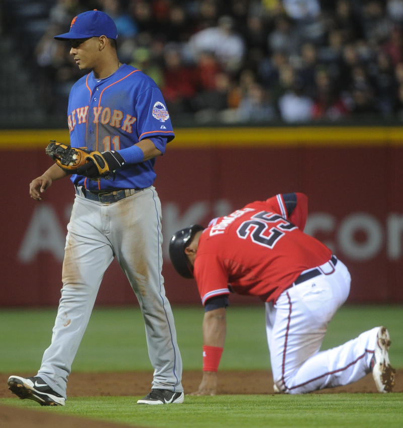New York Mets shortstop Ruben Tejada,  (11) walks away from Atlanta Braves' Juan Francisco (25) after he was tagged out at second base during the third inning of a baseball game, Friday, May 3, 2013, in Atlanta. (AP Photo/John Amis)