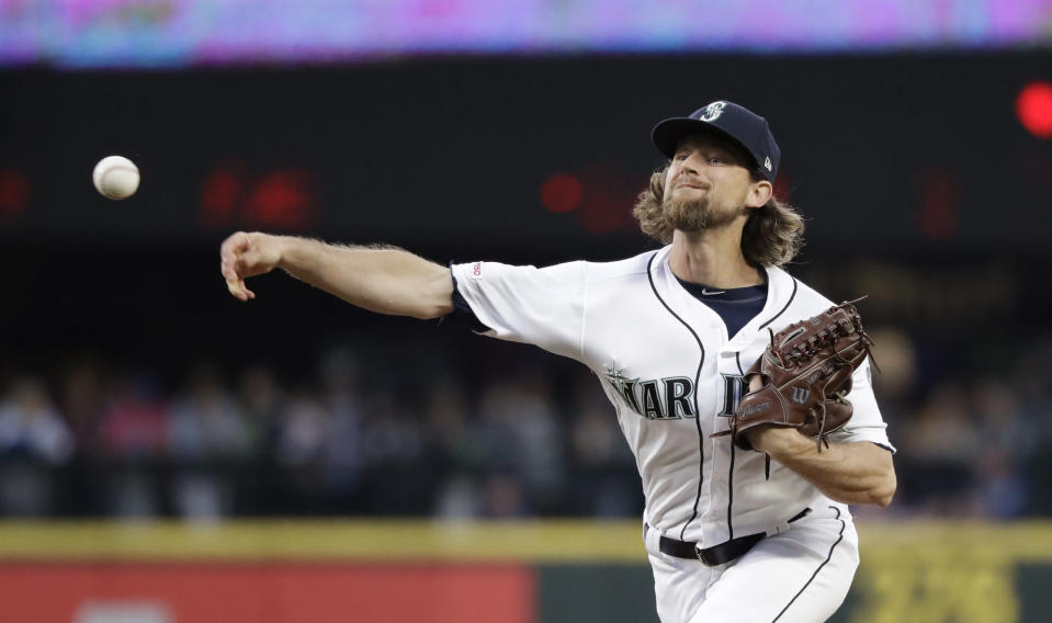 Seattle Mariners starting pitcher Mike Leake throws to a St. Louis Cardinals batter during the fifth inning of a baseball game Wednesday, July 3, 2019, in Seattle. (AP Photo/Elaine Thompson)