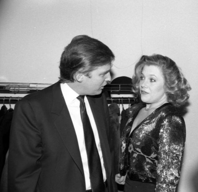 Donald Trump and Kathleen Turner talk at New York City's Lincoln Center Library in February 1988. (Photo: Tom Gates/Getty Images)