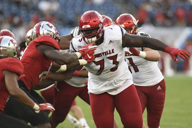 "Louisville offensive lineman Mehki Becton (73) throws some blocks during a game against Western Kentucky on Sept. 14. <span class=""copyright"">(Mike Strasinger / Associated Press)</span>"