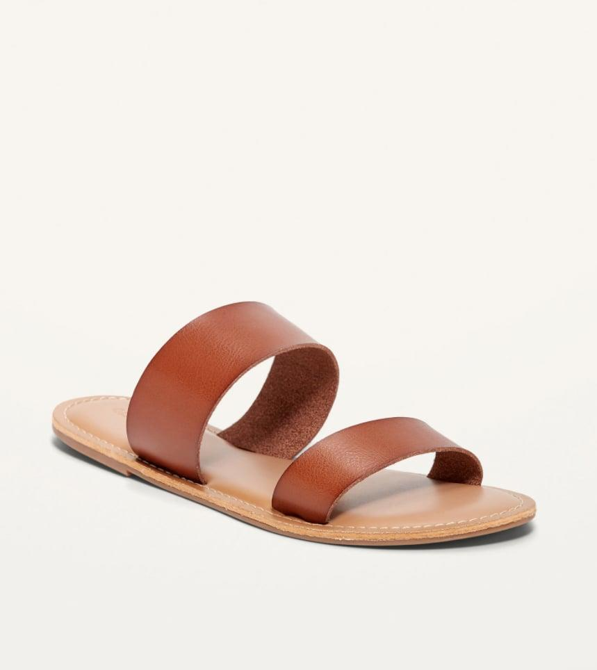 <p>Sport these chic <span>Faux-Leather Double-Strap Slide Sandals</span> ($14, originally 20) every day! The insoles are made with memory foam so it's super comfortable. These come in a variety of colors including black, white, and snake skin.</p>