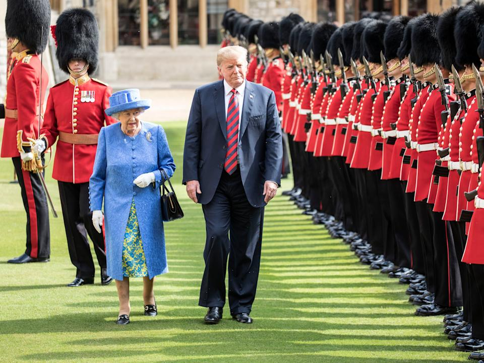 Donald Trump and Britain's Queen Elizabeth II inspect a Guard of Honour, formed of the Coldstream Guards at Windsor Castle, 13 July 2018Getty Images