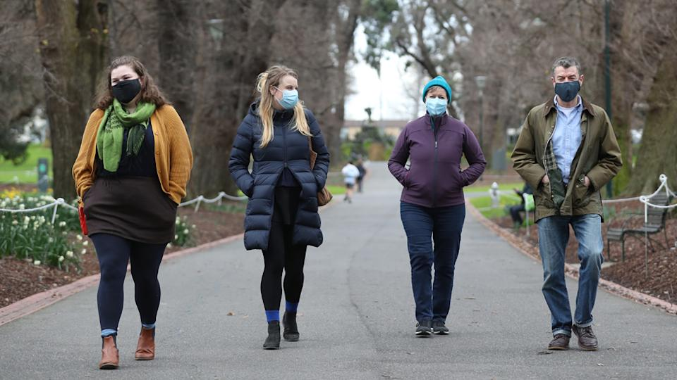Melbourne locals wearing mandatory face masks
