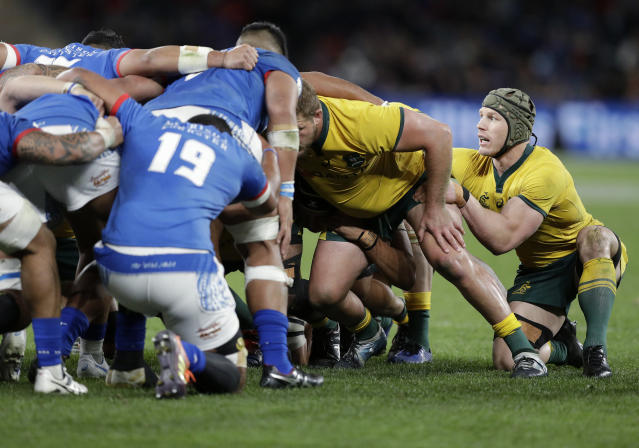 Australia's David Pocock, right, prepares to join a scrum on the flank during their rugby union test match against Samoa in Sydney, Saturday, Sept. 7, 2019. (AP Photo/Rick Rycroft)
