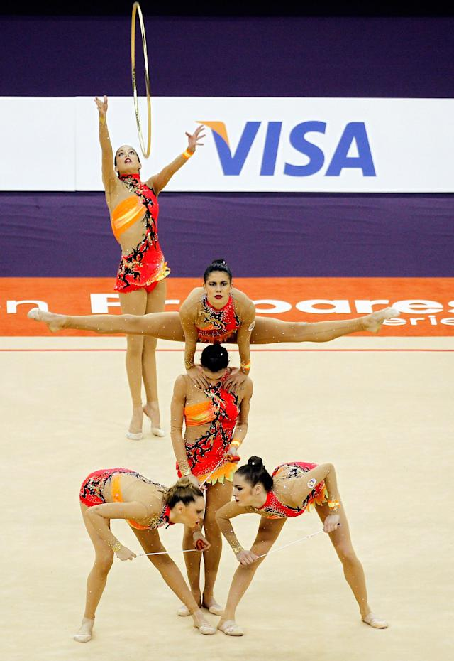LONDON, ENGLAND - JANUARY 18: The Spain team in action in the Group All-Around during the FIG Rhythmic Gymnastics Olympic Qualification round at North Greenwich Arena on January 18, 2012 in London, England. (Photo by Paul Gilham/Getty Images)