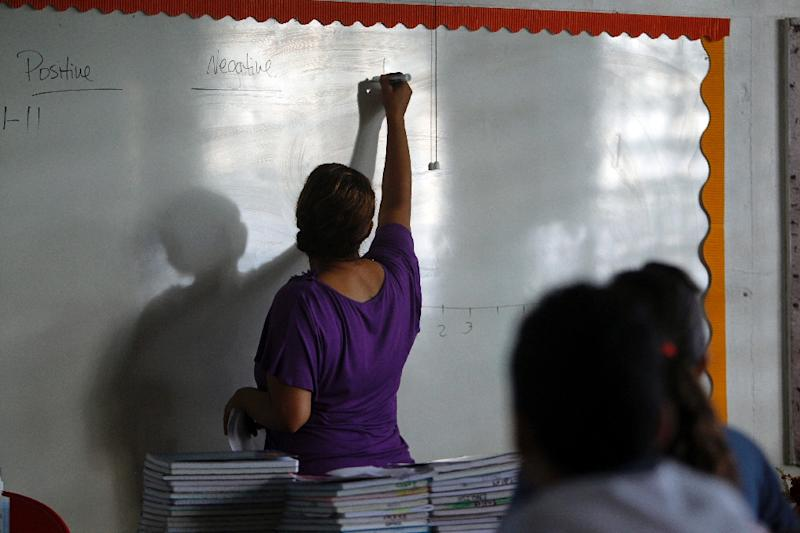 Joan Rodriguez teaches English class to her 6th grade students at the Sotero Figueroa Elementary School in San Juan (AFP Photo/Ricardo ARDUENGO)