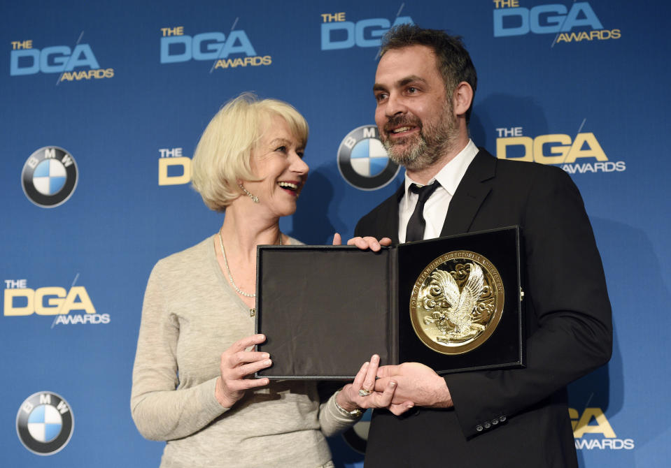 """Miguel Sopochnik, right, director of the """"The Battle of the Bastards"""" episode of """"Game of Thrones,"""" poses backstage with his Dramatic Series award along with presenter Helen Mirren at the 69th Annual Directors Guild of America Awards at the Beverly Hilton on Saturday, Feb. 4, 2017, in Beverly Hills, Calif. (Photo by Chris Pizzello/Invision/AP)"""
