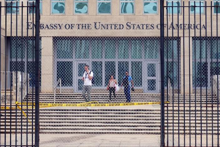 Workers at the U.S. Embassy in Havana leave the building on Sept. 29, 2017, after the State Department announced that it was withdrawing all but essential personnel from the embassy because Cuba could no longer guarantee diplomats' safety. (Photo: Emily Michot/Miami Herald/TNS via Getty Images)