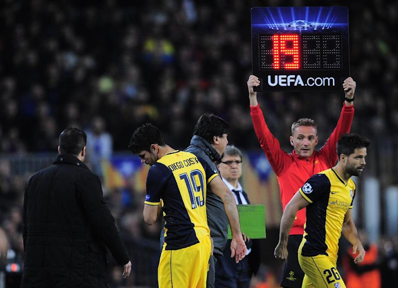 Atletico's Diego Costa, 2nd left leaves the field after getting injured as Diego comes on in his place during a first leg quarterfinal Champions League soccer match between Barcelona and Atletico Madrid at the Camp Nou stadium in Barcelona, Spain, Tuesday April 1, 2014