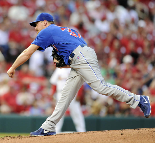 Chicago Cubs' starting pitcher Travis Wood throws against the St. Louis Cardinals in the first inning in a baseball game, Monday, May 12, 2014, at Busch Stadium in St. Louis. (AP Photo/Bill Boyce)