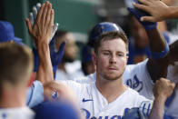 Kansas City Royals' Ryan O'Hearn is congratulated in the dugout for his three-run home run during the fourth inning of the team's baseball game against the Detroit Tigers at Kauffman Stadium in Kansas City, Mo., Friday, July 23, 2021. (AP Photo/Colin E. Braley)