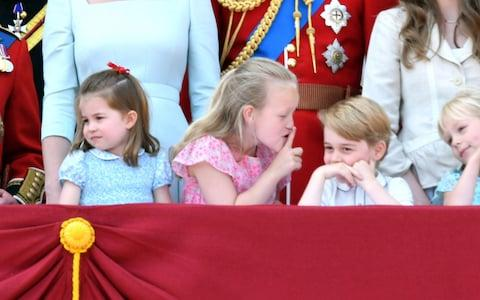 Princess Charlotte stands next to Savannah Phillips and Prince George at Trooping The Colour 2018 - Credit: Karwai Tang/WireImage